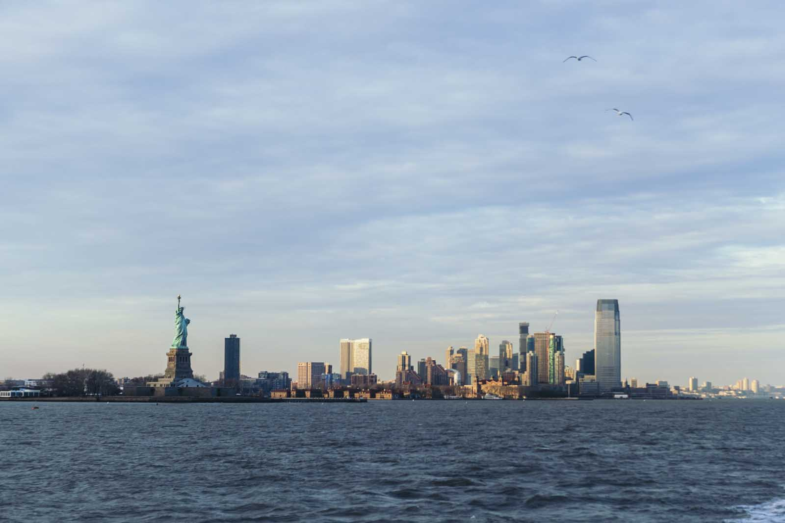 View of Manhatten and Statue of Liberty from Ferry