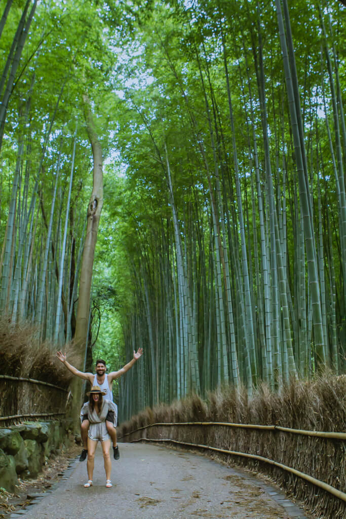Boy rides girls back at Arashiyama Bamboo Forest
