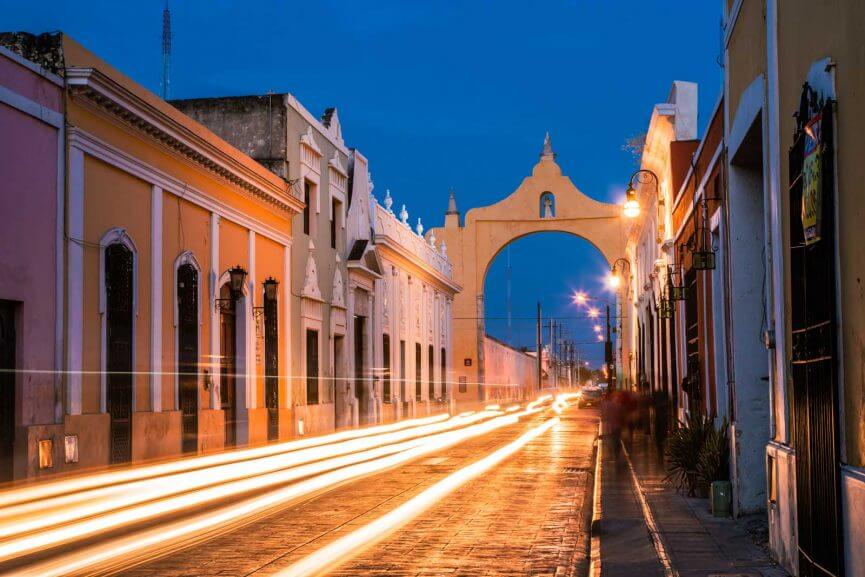 archway in Merida mexico with light trails