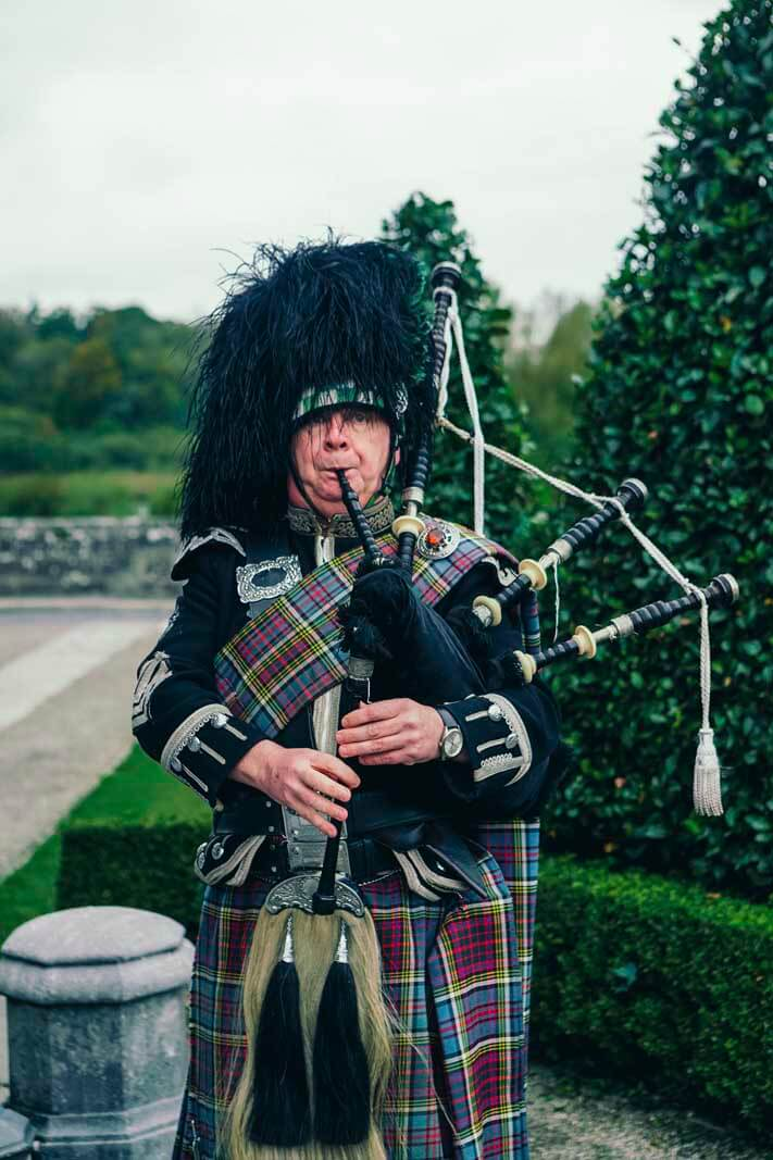 Bag pipe player at Dromoland Castle Hotel in Ireland