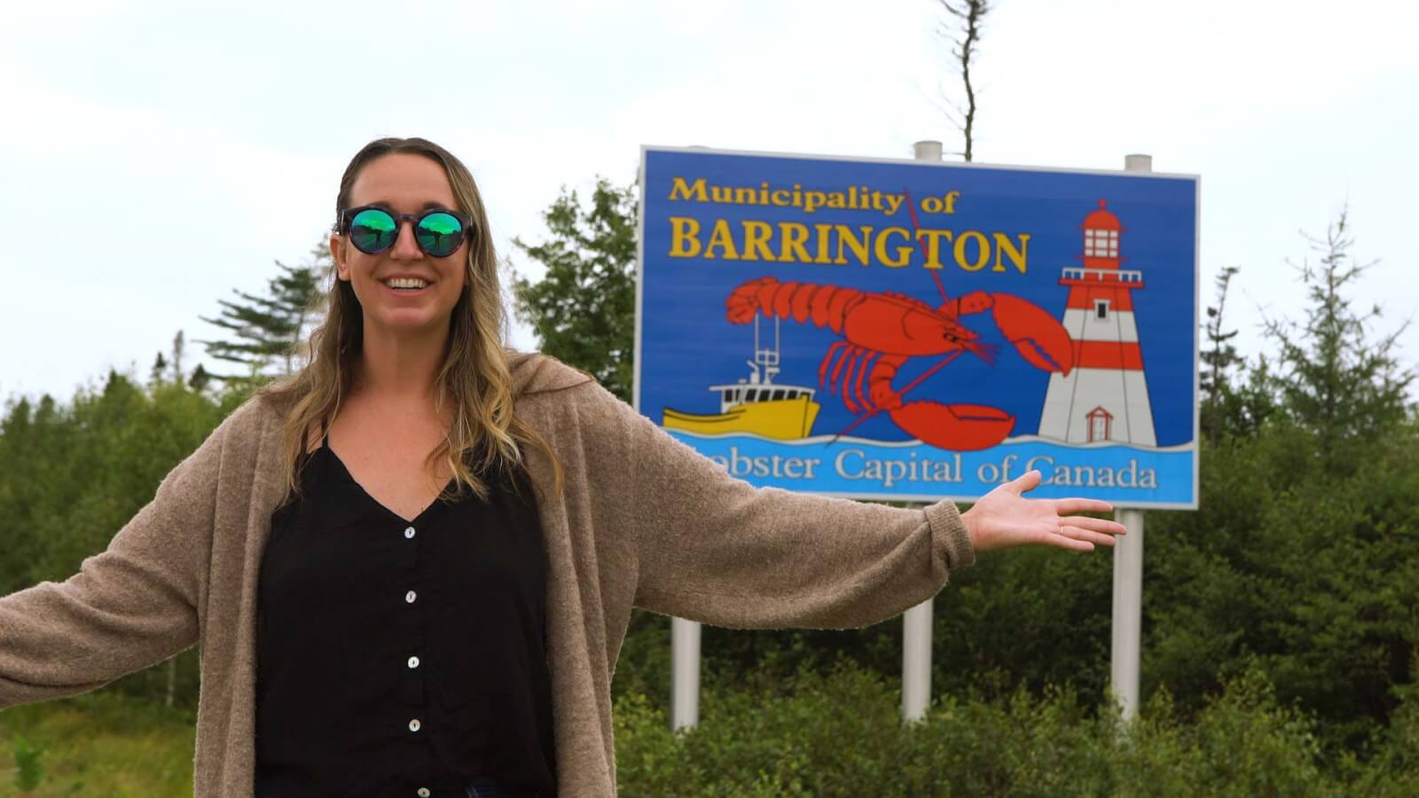 Megan in front of the Barrington Lobster Capital of Canada sign