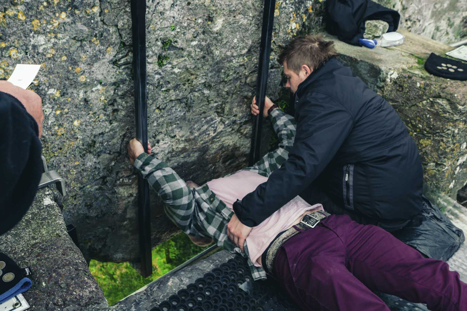 Scott kissing the Blarney Stone near Cork Ireland