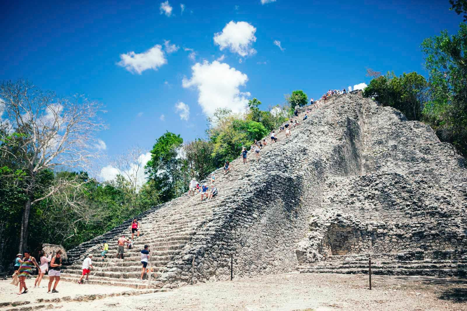 People climbing Coba Ruins