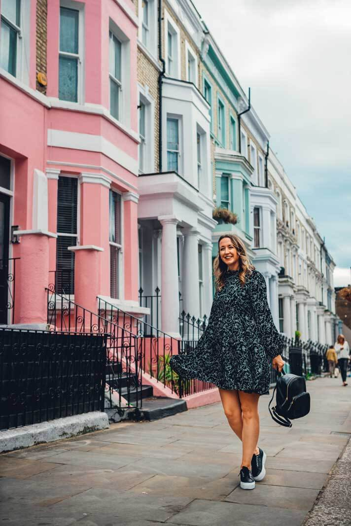 Megan by the pastel row of homes in Notting Hill London