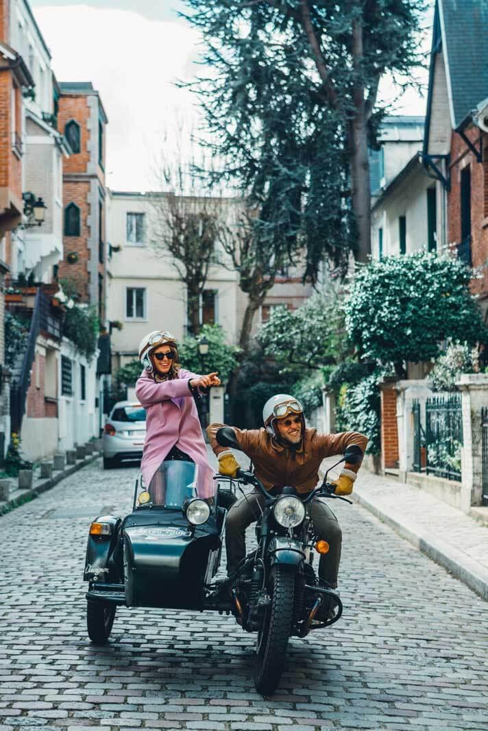 Driving on a motorcyle down Villa Leandre in Montmartre Paris