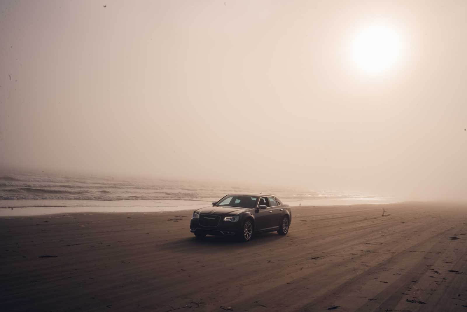 driving the car on a foggy Crescent Beach near LaHave in Nova Scotia