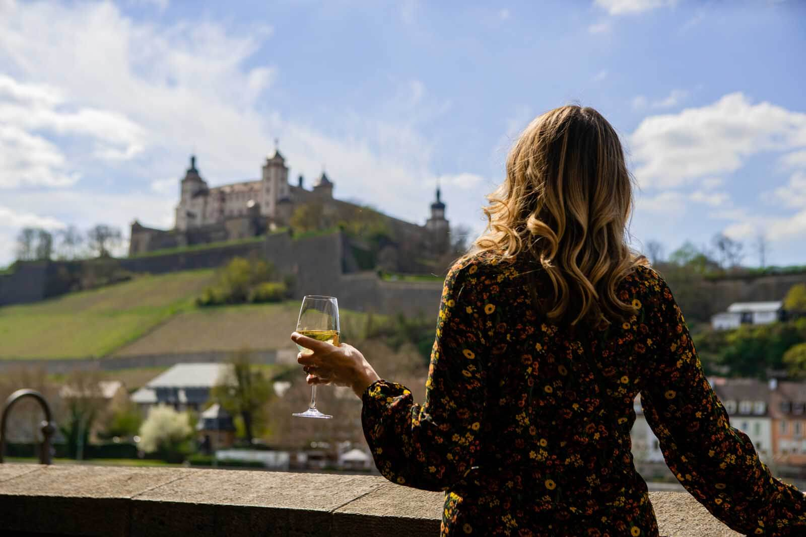 Megan enjoying a glass of wine on the old main bridge in Würzburg Germany
