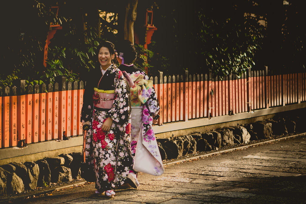 Geisha posing with sword in Gion