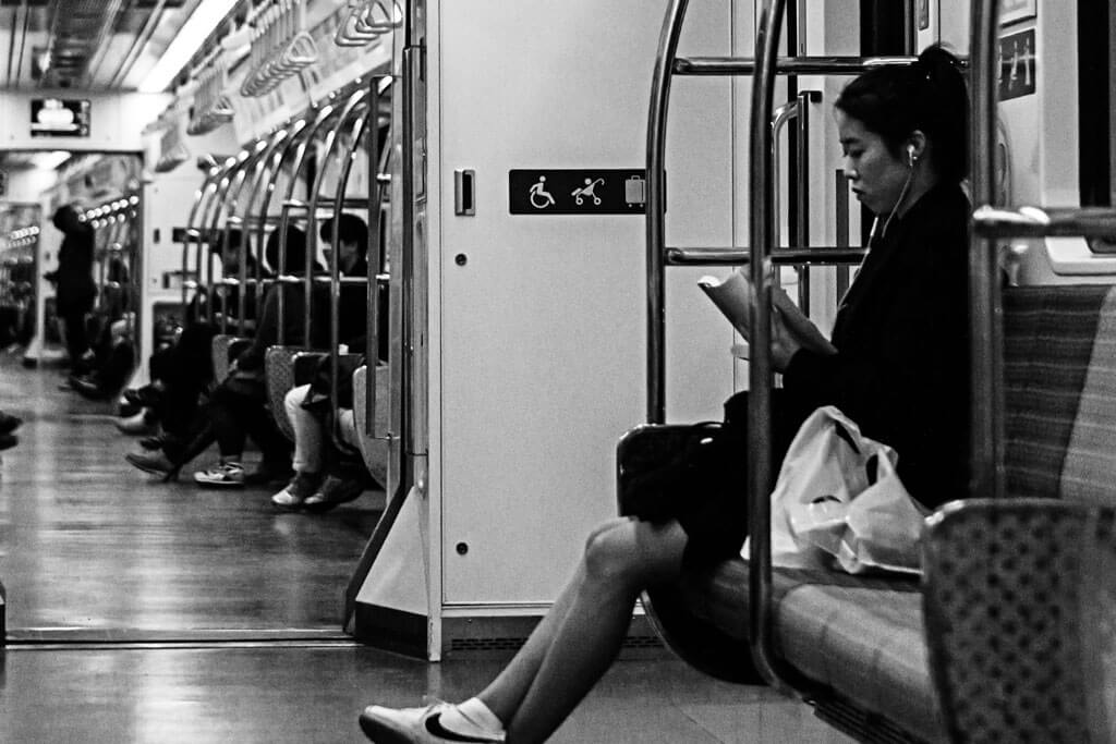 Girl reading on subway in Seoul