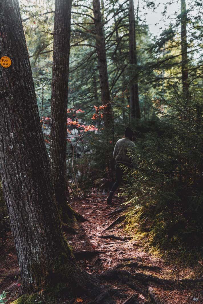 Hiking around Lake Sagamore on aan Adirondacks road trip in Upstate New York in the Fall