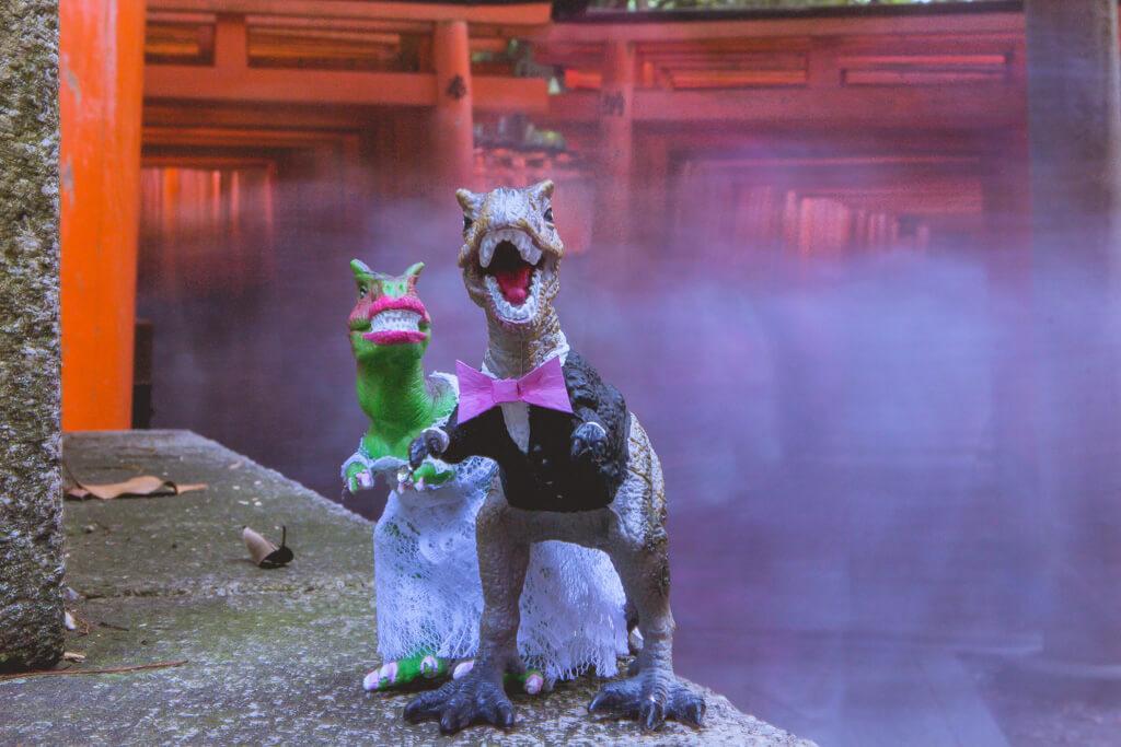 Dinosaurs pose in front Fushimi Inari Tori Gates