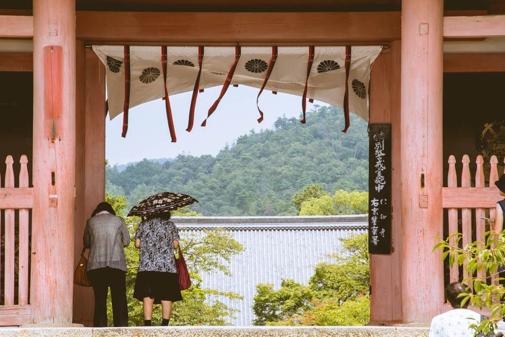 two ladies at a shrine in kyoto