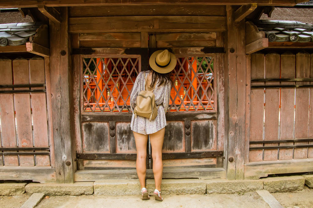 peaking in a shrine in kyoto