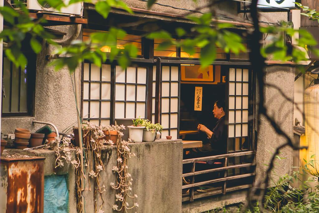 Man in window at kawaramachi kyoto