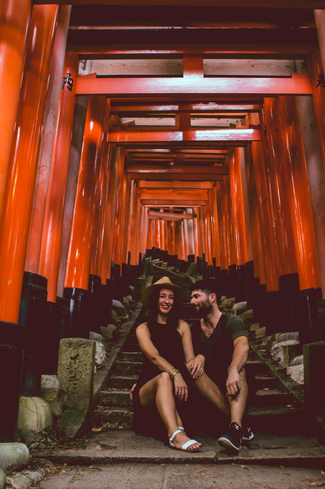 Couple posing at Fushimi Inari Tori Gates