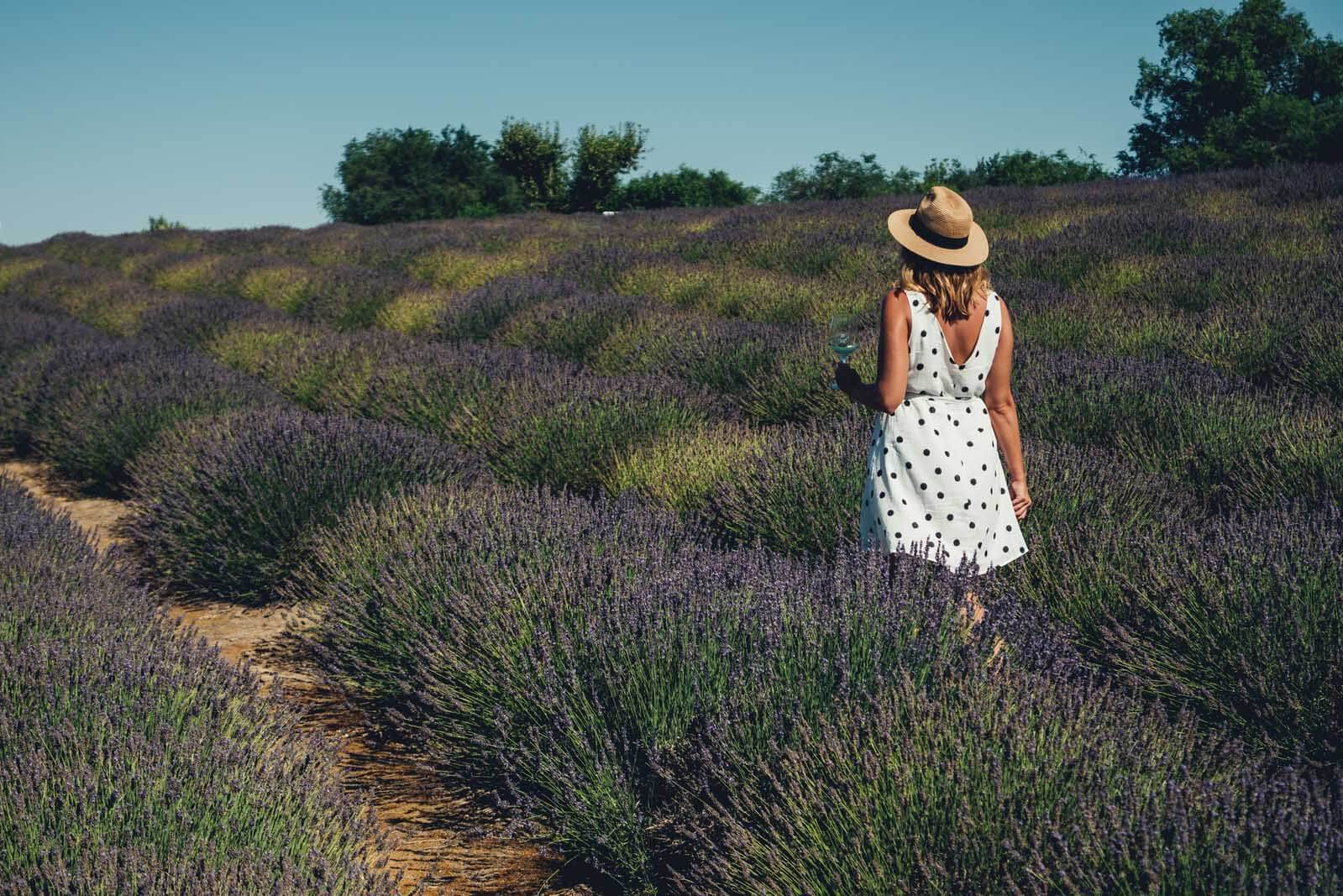 Megan walking through J Bell Winery and Lavender Fields