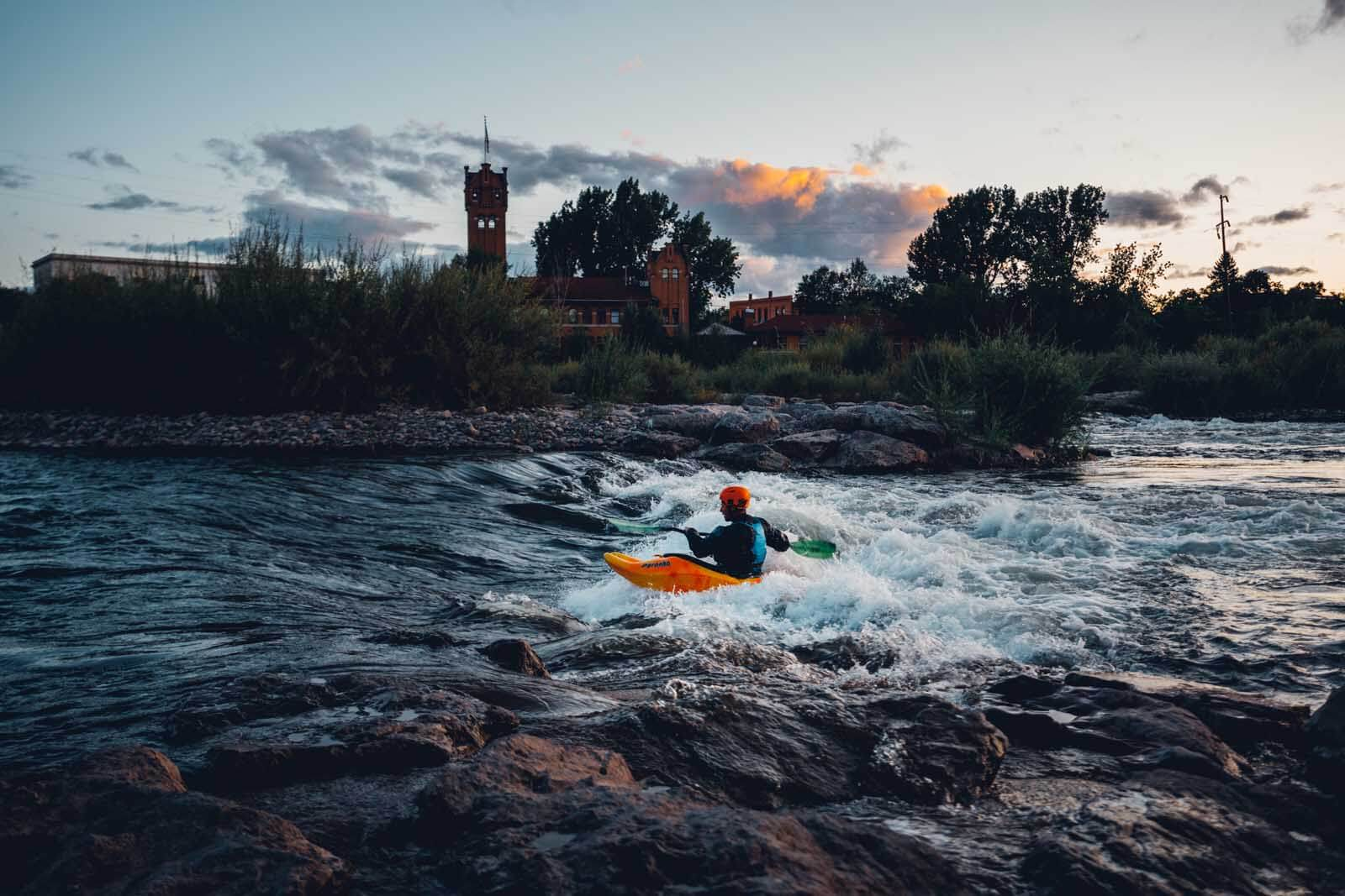 Kayaker practicing at Brennans Wave in Missoula Montana