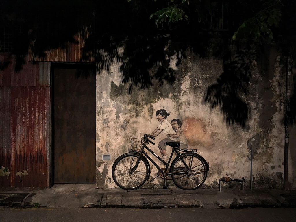 famous Penang street art -- little girl and boy on a bicycle