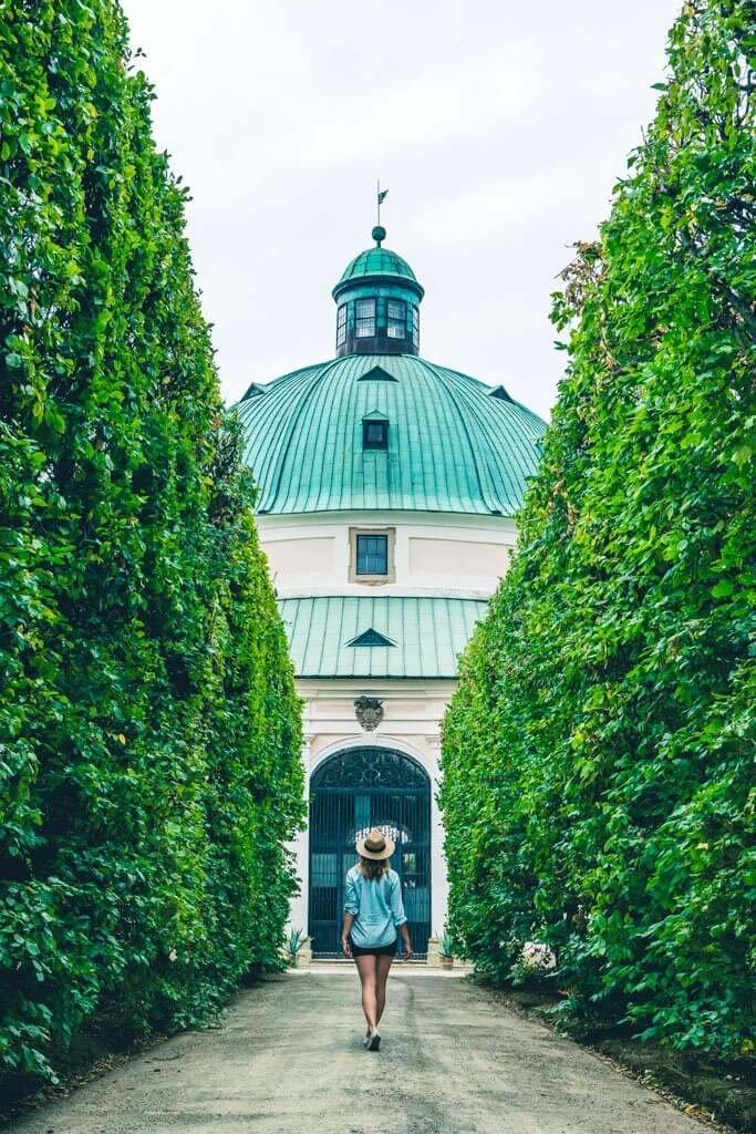 Megan walking through the castle gardens in Kromeriz Czech Republic towards the rotunda