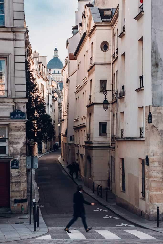 Man walking across the street in Rome