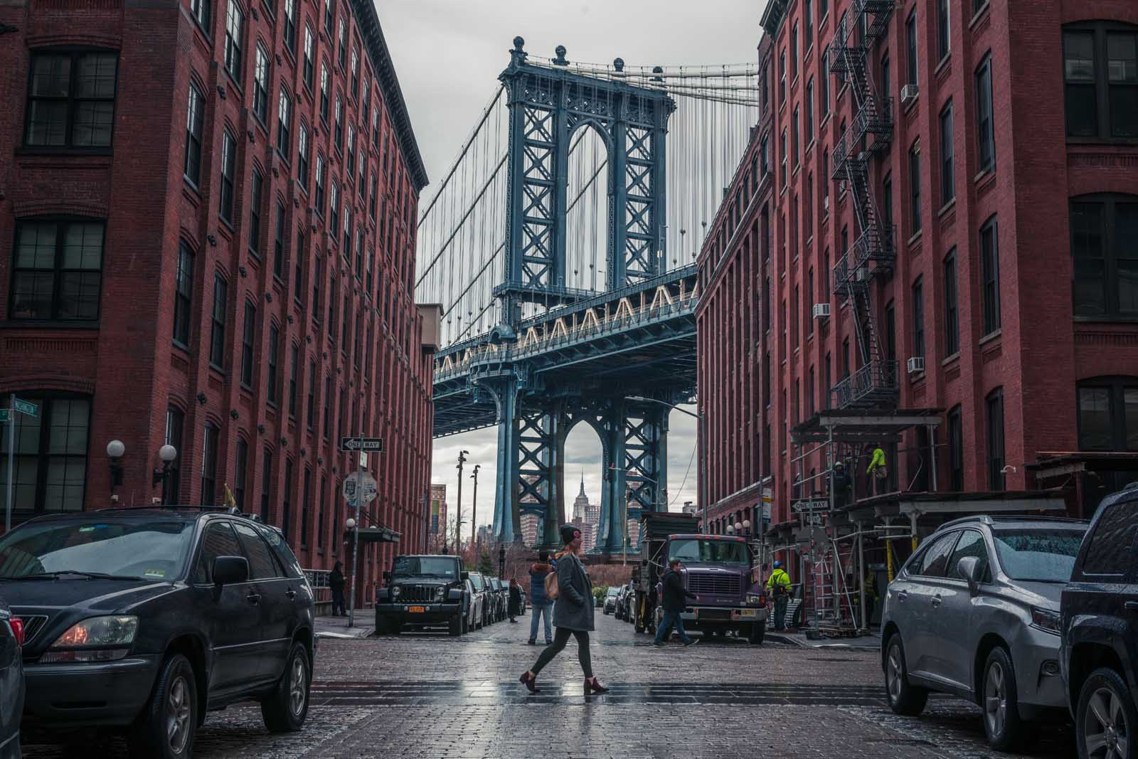 Megan walking in the iconic DUMBO spot
