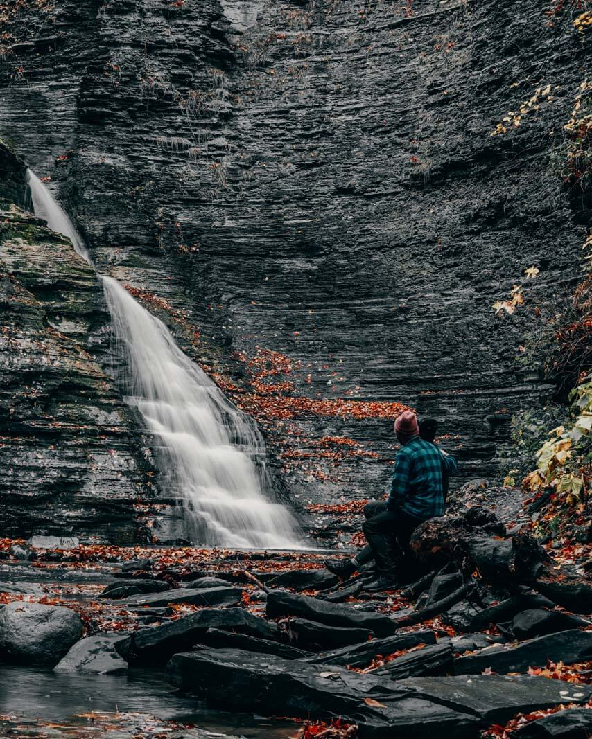 Megan and Scott sitting at admiring the second waterfall in Grimes Glen Park in Naples New York