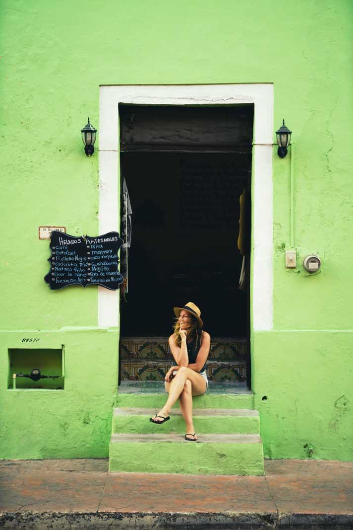 Megan at a fun green building in Valladolid