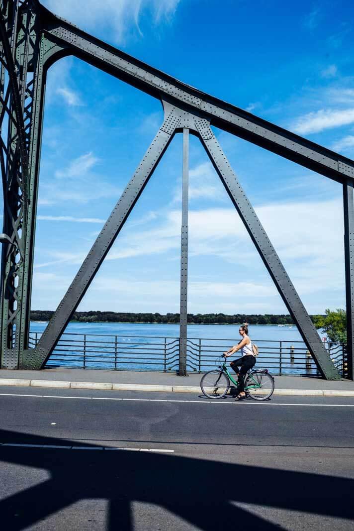 Megan biking across the Bridge of Spies