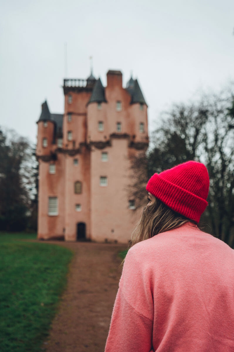 Megan-looking-at-Craigievar-Castle-in-Scotland