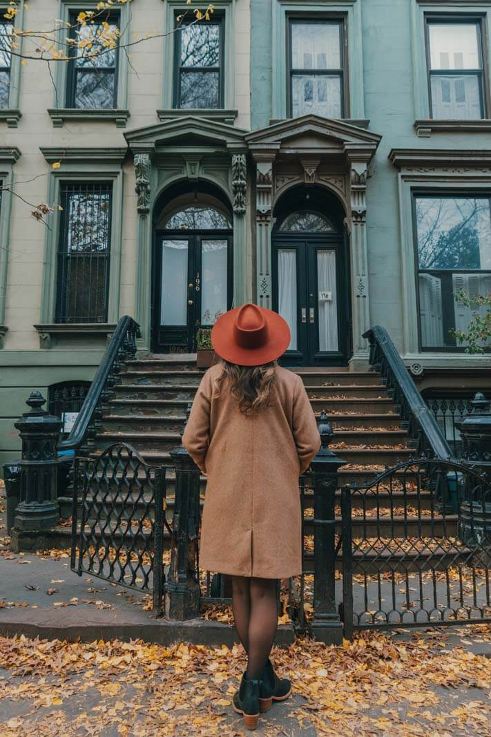 Megan looking at the brownstones in Park Slope Brooklyn