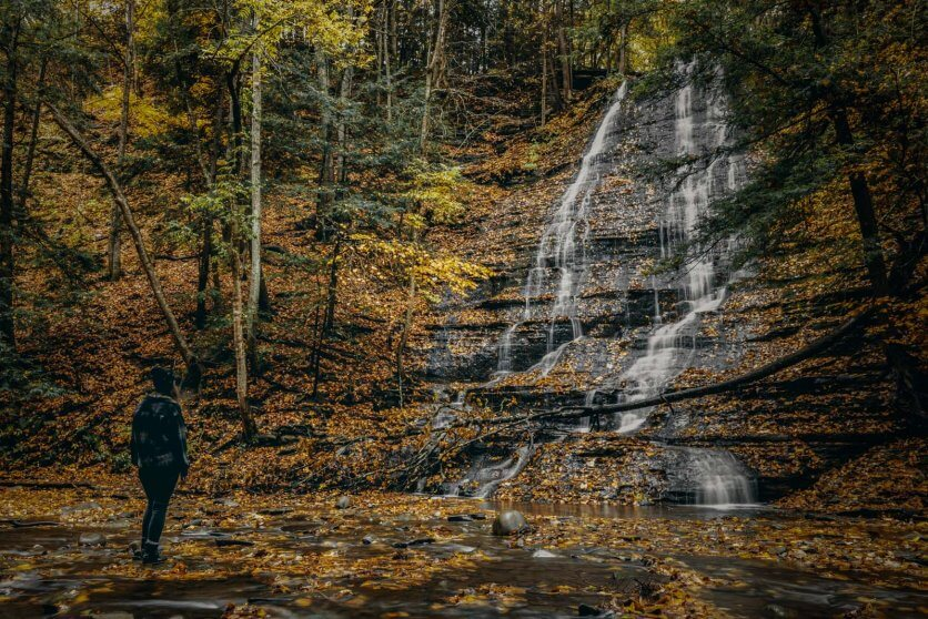 Megan looking at the first waterfall in Grimes Glen Park in Naples New York the Finger Lakes