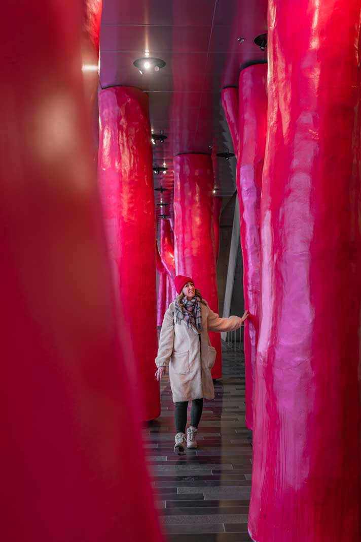 Megan walking through Lipstick Forest by Claude Cormier in Palais Congres in Montreal