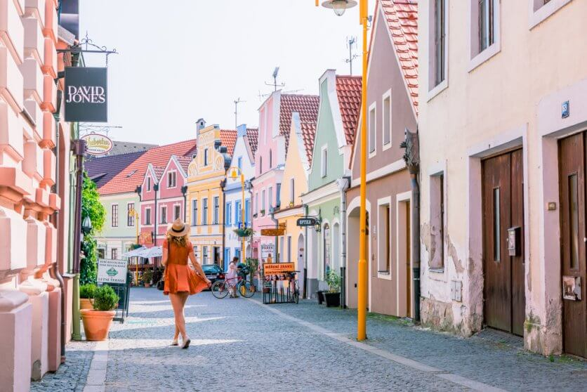 Megan walking through the colorful streets of Trebon Czech Republic