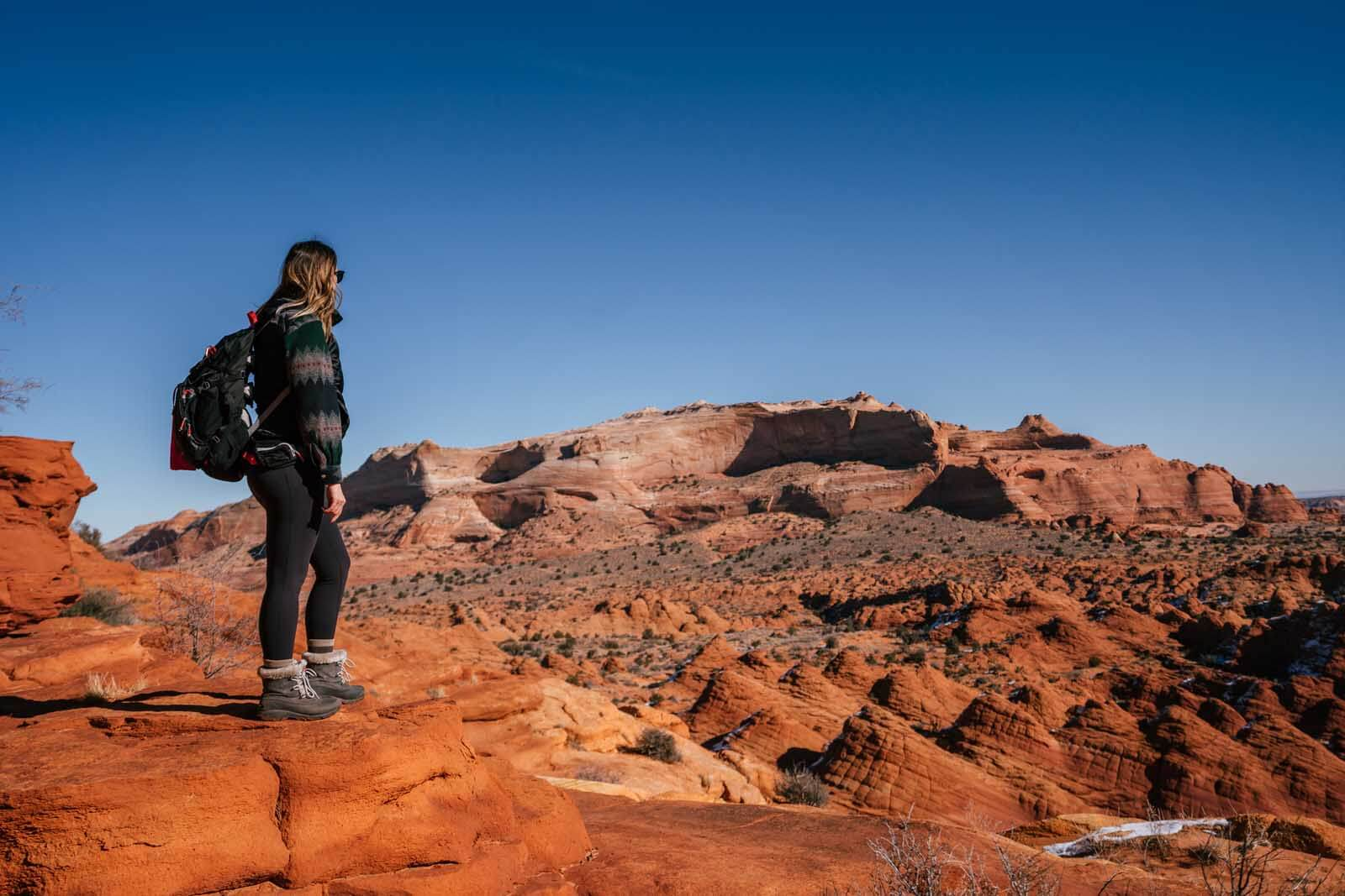 Megan looking at the view of the teepees at Coyote Buttes North