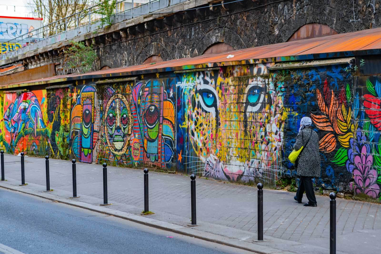 the colorful murals in Ourcq the Paris Street Art Scene