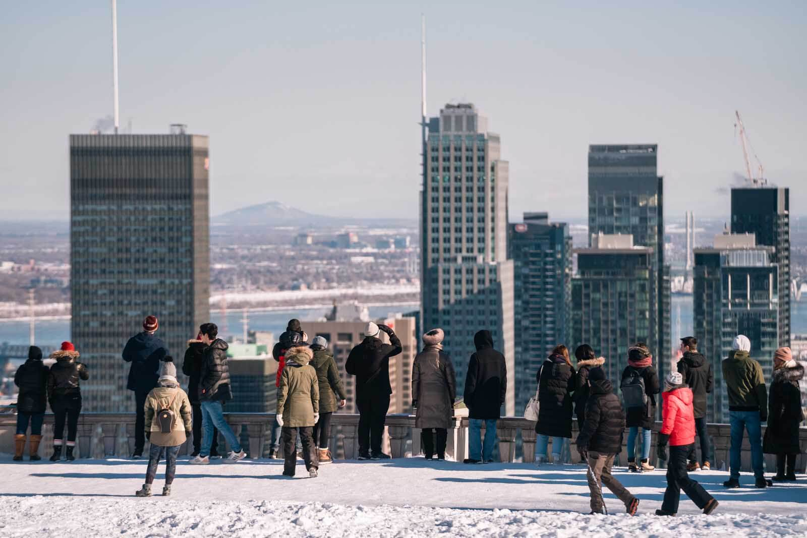 People enjoying the view at Mont Royal of Montreal below