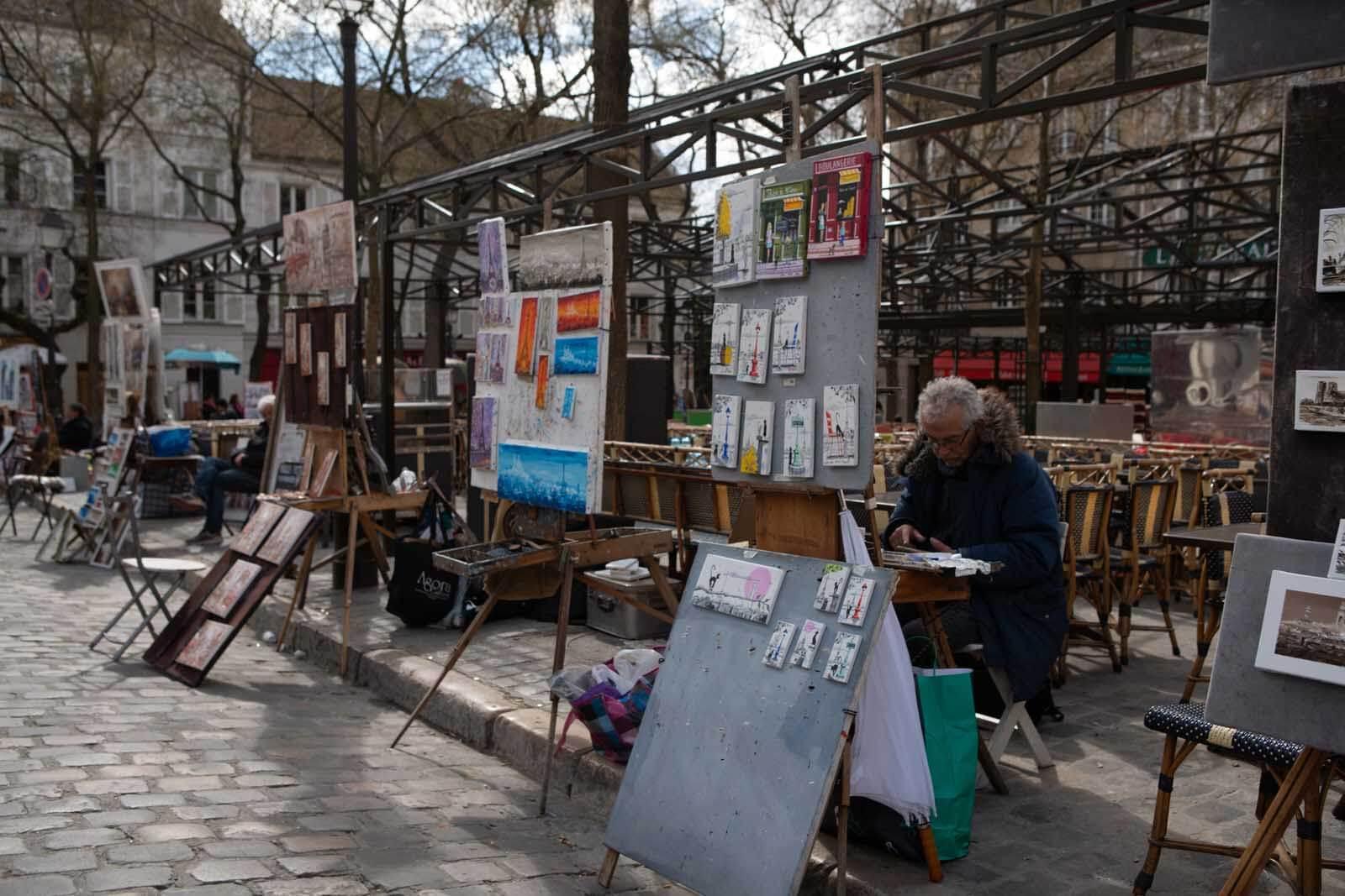 Place de Tertre artists at work in Montmartre Paris