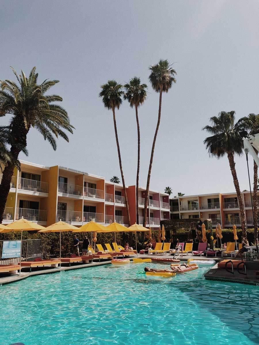 Saguaro-Palm-Springs-weekend-getaway-at-their-hotel-pool-in-California
