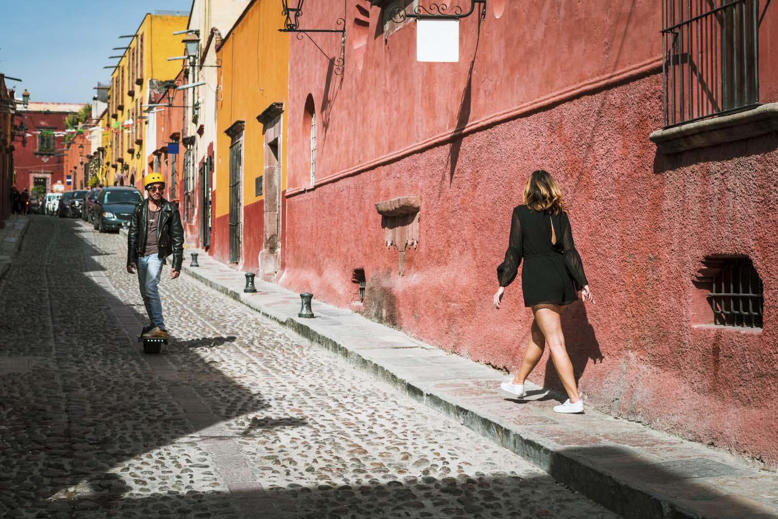 Skateboarder coming down cobblestone streets in San Miguel de Allende