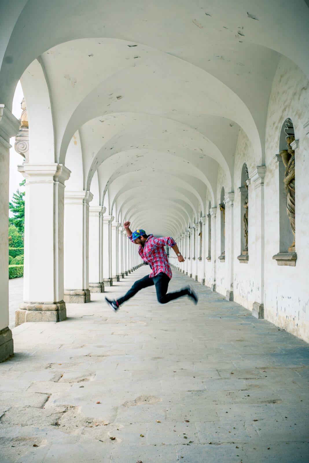 Scott jumping in the colonnade in the Castle gardens of Kromeriz