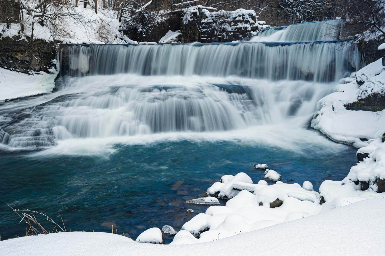 Seneca Mills Waterfall on the Keuka Outlet Trail in winter in Finger Lakes Wine Country New York