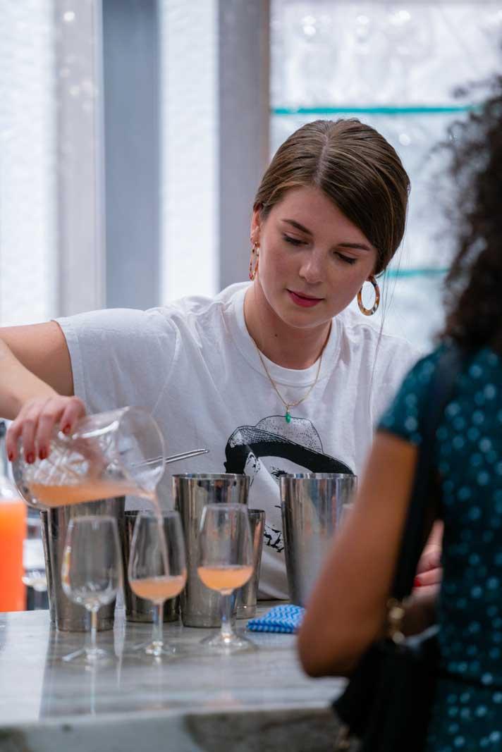 Spirited Away Festival bartender challenge Ellie pouring. a drink