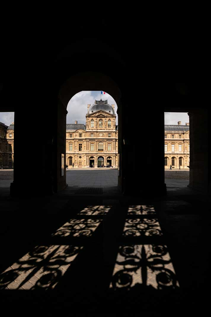 The Louvre Museum in Paris through the shadows