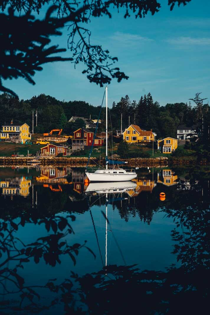 the boat floating and reflection in the water in Hubbards Nova Scotia