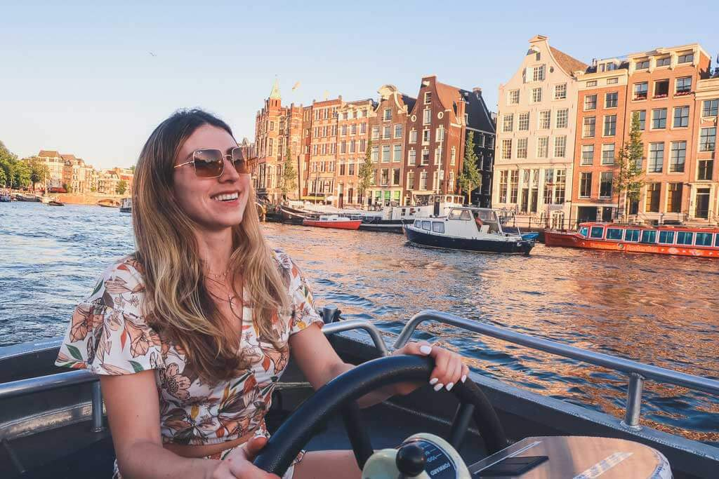 Valentina on a boat in Amsterdam's canals