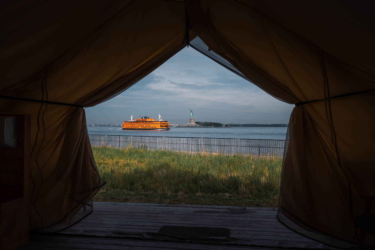 View of Statue of Liberty and Staten Island Ferry from Governors Island glamping