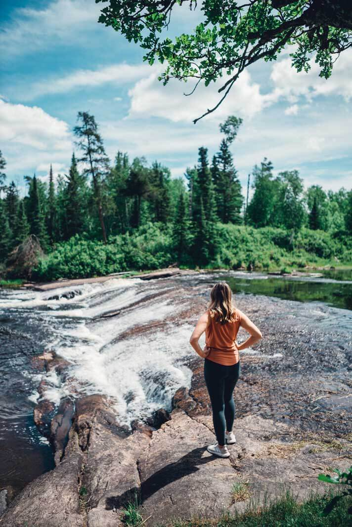 Megan standing at Whiteshell Provincial Park looking at waterfall
