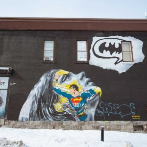 Wonder woman thinking about Batman in Montreal mural
