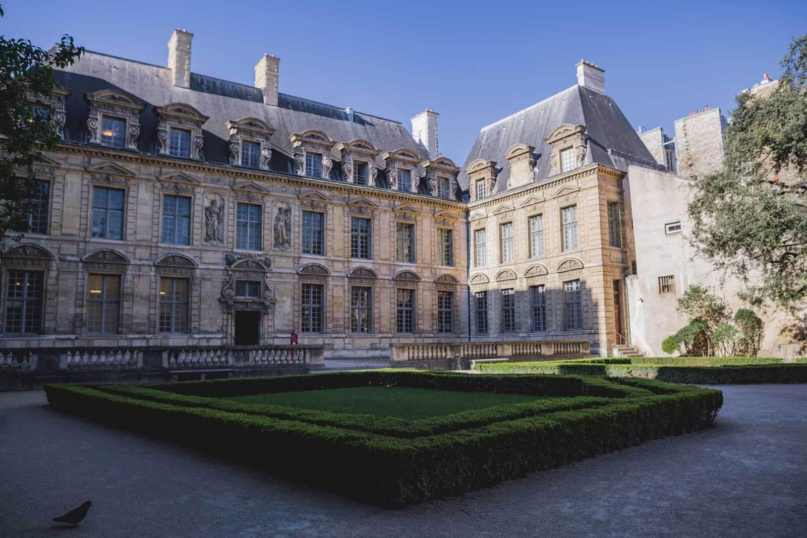 the pretty gardens of hotel de sully in le marais paris
