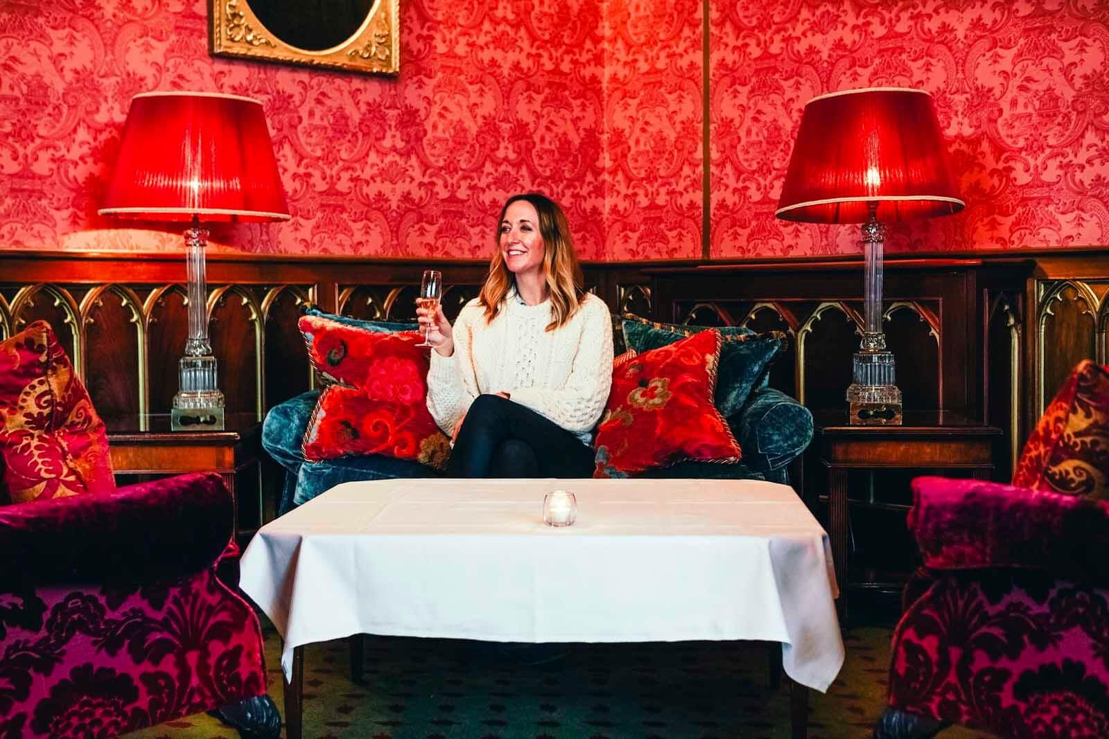 Megan having a drink inside Dromoland Castle Hotel